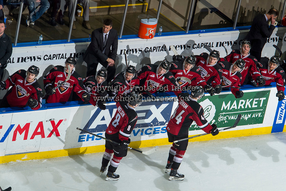 KELOWNA, BC - JANUARY 26: Michael Dyck, head coach of the Vancouver Giants, stands on the bench as Tristen Nielsen #8 and Bowen Byram #44 skate past to celebrate a goal against the Kelowna Rockets at Prospera Place on January 26, 2019 in Kelowna, Canada. (Photo by Marissa Baecker/Getty Images)