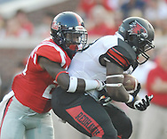 Mississippi defensive back Mike Hilton (28) tackles Southeast Missouri State's Lewis Washington (28) at Vaught-Hemingway Stadium in Oxford, Miss. on Saturday, September 7, 2013. (AP Photo/Oxford Eagle, Bruce Newman)
