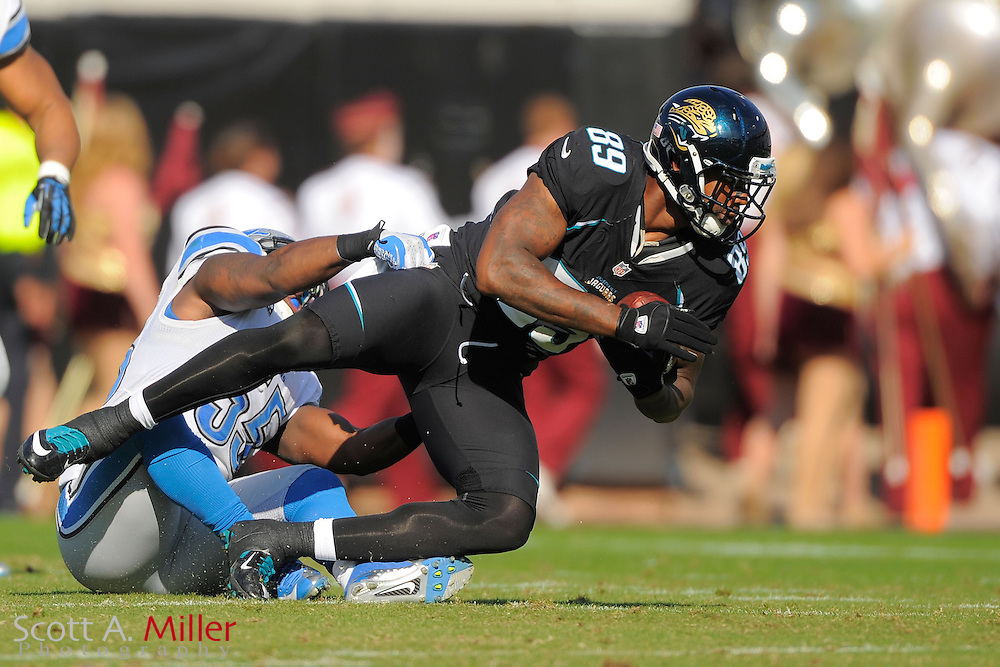 Jacksonville Jaguars tight end Marcedes Lewis (89) is tackled by Detroit Lions middle linebacker Stephen Tulloch (55) during the Lions 31-14 win at EverBank Field on November 4, 2012 in Jacksonville, Florida. ..©2012 Scott A. Miller..