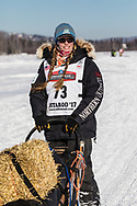 Musher Kristy Berington competing in the 45rd Iditarod Trail Sled Dog Race on the Chena River after leaving the restart in Fairbanks in Interior Alaska.  Afternoon. Winter.