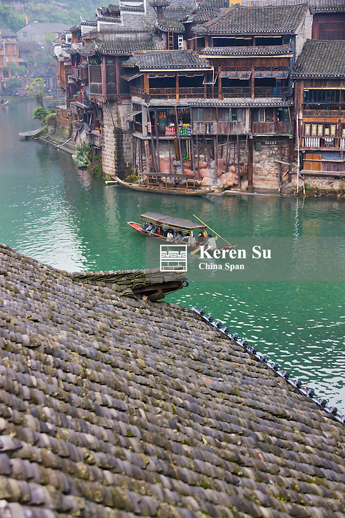 Traditional houses and boat on the river in the ancient town, Fenghuang, Hunan Province, China
