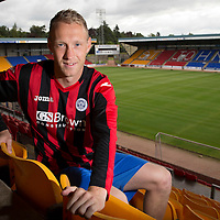St Johnstone's Steven Anderson pictured at McDiarmid Park this morning ahead of Thursday's Europa League qualifier against FC Luzern..Steven is pictured wearing the new St Johsntone away strip which will be worn for the first time on Thursday...15.07.14<br /> Picture by Graeme Hart.<br /> Copyright Perthshire Picture Agency<br /> Tel: 01738 623350  Mobile: 07990 594431