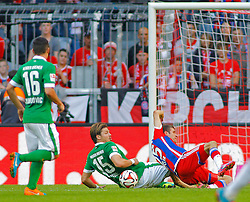 MUNICH, GERMANY - OCTOBER 18: Sebastian Prodl of Werder Bremen commits a foul on Thomas Muller of Bayern Munich to concede a penalty during the Bundesliga match between Bayern Munich and Werder Bremen. October 18, 2014 in Munich, Germany. Photo mandatory by-line: Mitchell Gunn