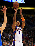 Feb. 17, 2011; Phoenix, AZ, USA; Phoenix Suns forward Channing Frye (8) puts up a basket against the Dallas Mavericks at the US Airways Center. The Mavericks defeated the Suns 112-106. Mandatory Credit: Jennifer Stewart-US PRESSWIRE