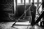 A monk practices sacred songs on a large ceremonial trumpet at a rural Buddhist temple. Haa Valley, Bhutan. / Un monje practica música sagrada en una trompeta ceremonial en un templo budista rural. Valle de Haa, Bután