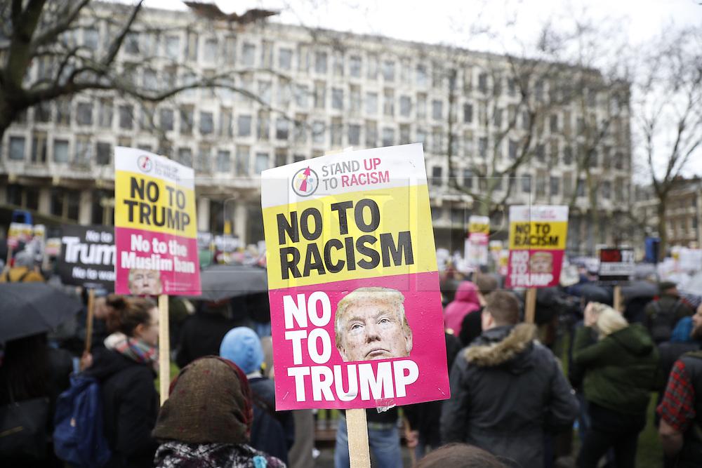 © Licensed to London News Pictures. 04/02/2017. London, UK. A demonstration against U.S President Donald Trump's Executive Order banning refugees and immigrants from a number of Muslim-majority countries. Protestors join campaign groups including Stop the War, Stand up to Racism, Muslim Association of Britain, in a march from the U.S Embassy in London to Downing Street. Photo credit: Peter Macdiarmid/LNP