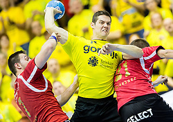 Marko Dujmovic of RK Gorenje between Marcel Hess and Oliver Scheuner  of Winterthur during handball match between RK Gorenje Velenje (SLO) and Pfadi Winterthur (SUI) in Group Phase of EHF European Cup 2014/15, on March 8, 2015 in Rdeca dvorana, Velenje, Slovenia. Photo by Vid Ponikvar / Sportida