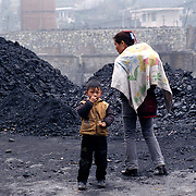Many of the villagers of Wangjiazhai work with coal from selling to refining, digging and collecting.  Their homes and lifestyle are quite poor and coal seems to be part of it from being a source of income to be is used for heating and cooking. Children help their parents in collecting coal.