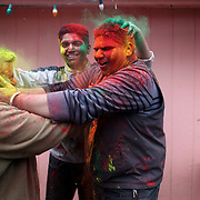 Participants rub each other with gulal, or powdered color, during a Holi festival at the Sanatan Dharma Hindu Temple and Cultural Center in Maple Valley on Saturday, March 10, 2012. Holi, the Festival of Colors, is a Hindu festival welcoming spring. It is most well-known for the vibrant bursts of gulal, the powdered dye, that festivalgoers throw on each other. (Joshua Trujillo, seattlepi.com)