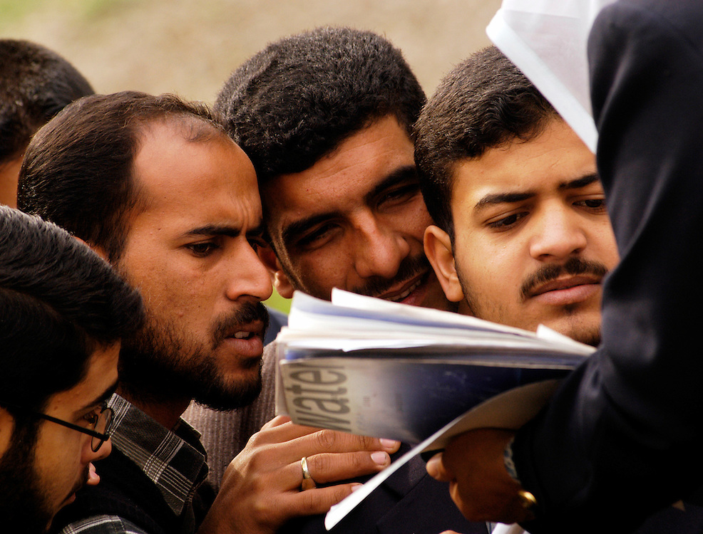 Students look over documents at the al-Wathba water treatment plant in Baghdad. Many of these students will go on to work at water treatment centers throughout Iraq.