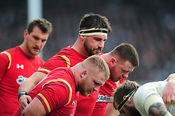 The Wales front row pack down for a scrum - Mandatory byline: Patrick Khachfe/JMP - 07966 386802 - 12/03/2016 - RUGBY UNION - Twickenham Stadium - London, England - England v Wales - RBS Six Nations.