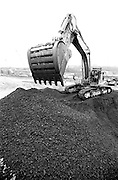 CAT Loader dumping gravel at Heathrow Airport expansion