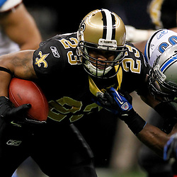 January 7, 2012; New Orleans, LA, USA; New Orleans Saints running back Pierre Thomas (23) is tackled by Detroit Lions linebacker Stephen Tulloch (55) during the 2011 NFC wild card playoff game at the Mercedes-Benz Superdome. Mandatory Credit: Derick E. Hingle-US PRESSWIRE