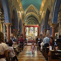 VENICE, ITALY - AUGUST 14:  A young worshipper returns to her seat after the Holy Communion during a solemn Mass for the celebration of the Assumption at the Armenian monastery of San Lazzaro on August 14, 2011 in Venice, Italy. The Armenian Monastery is based on San Lazzaro which is a small island in the Venetian Lagoon lying immediately west of the Lido it is completely occupied by the monastery, founded around 1707, is the mother-house of the Mekhitarist Order, the island is one of the world's foremost centers of Armenian culture