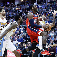 08 March 2017: Washington Wizards guard John Wall (2) goes for the layup past Denver Nuggets guard Jamal Murray (27), Denver Nuggets guard Will Barton (5) and Denver Nuggets forward Darrell Arthur (00) during the Washington Wizards 123-113 victory over the Denver Nuggets, at the Pepsi Center, Denver, Colorado, USA.