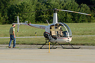 Montgomery, NY - A pilot checks out hisRobinson R22 Beta helicopter before taking off from Orange County Airport on July 26, 2008.