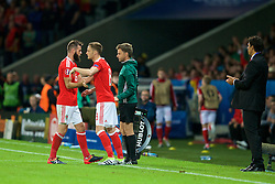 LILLE, FRANCE - Friday, July 1, 2016: Wales' Joe Ledley shakes hands with Andy King as he leaves the field following his substitution during the UEFA Euro 2016 Championship Quarter-Final match against Belgium at the Stade Pierre Mauroy. (Pic by Paul Greenwood/Propaganda)