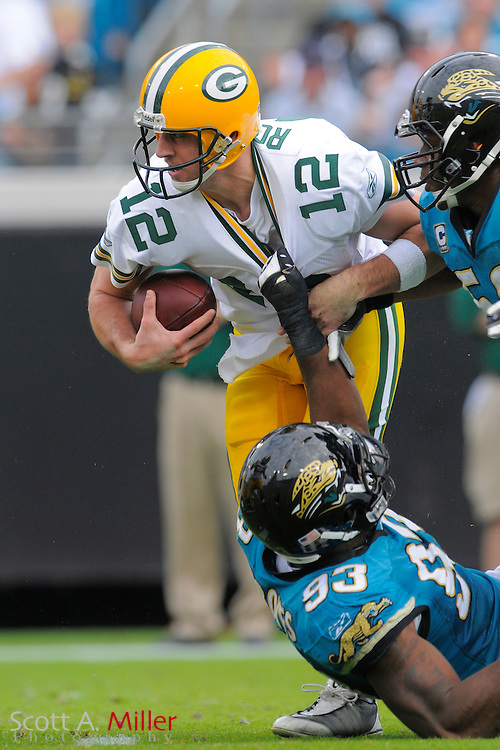 Jacksonville, FL. -- Green Bay Packers quarterback Aaron Rodgers (12) is sacked by Jacksonville Jaguars defensive end Quentin Groves (93) during the Packers game against the Jacksonville Jaguars on Dec. 14, 2008 at Jacksonville Municipal Stadium....©2008 Scott A. Miller