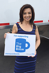 "© Licensed to London News Pictures . 19/01/2015 . Liverpool , UK . Ming Na Wen from Agents of Shield . Celebrities pose with "" Big Brew "" placards in support of mental health awareness as today (19th January 2015) marks "" Blue Monday "" , the day regarded by many as the most depressing in the year . Campaigners are urging the public to show support by tweeting sefies with their favourite brew and the hashtag "" #brewfie "" . In London , Deputy Prime Minister Nick Clegg , is announcing his campaign to improve mental health awareness , reduce stigma and promote a "" zero ambition "" target for suicide . Photo credit : Joel Goodman/LNP"