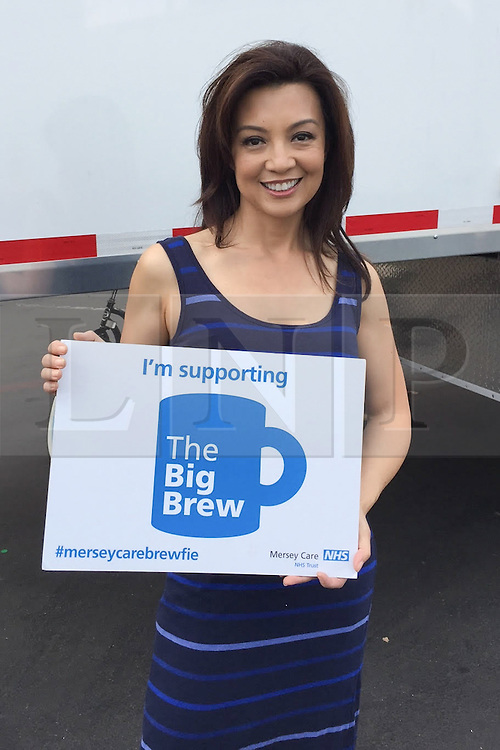 """© Licensed to London News Pictures . 19/01/2015 . Liverpool , UK . Ming Na Wen from Agents of Shield . Celebrities pose with """" Big Brew """" placards in support of mental health awareness as today (19th January 2015) marks """" Blue Monday """" , the day regarded by many as the most depressing in the year . Campaigners are urging the public to show support by tweeting sefies with their favourite brew and the hashtag """" #brewfie """" . In London , Deputy Prime Minister Nick Clegg , is announcing his campaign to improve mental health awareness , reduce stigma and promote a """" zero ambition """" target for suicide . Photo credit : Joel Goodman/LNP"""