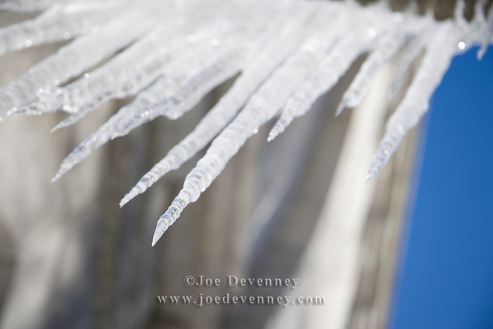 Icicles hanging from the eaves of a building