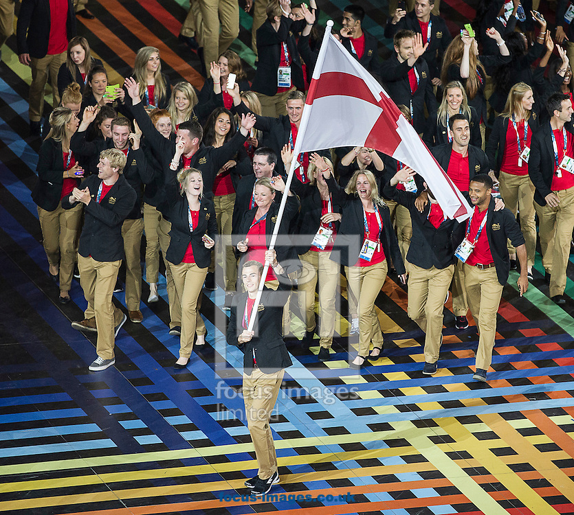 Nick Matthew ( bottom centre ) of England carries the flag as he leads the team during the Glasgow 2014 Commonwealth Games Opening Ceremony at Celtic Park, Glasgow<br /> Picture by Paul Terry/Focus Images Ltd +44 7545 642257<br /> 23/07/2014