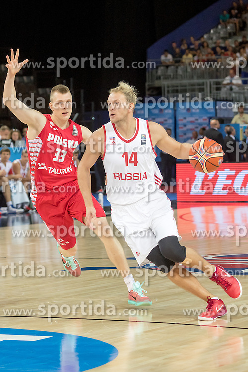 06.09.2015, Park Suites Arena, Montpellier, FRA, Russland vs Polen, Gruppe A, im Bild KAROL GRUSZECKI (33), ANTON PONKRASHOV (14) // during the FIBA Eurobasket 2015, group A match between Russia and Poland at the Park Suites Arena in Montpellier, France on 2015/09/06. EXPA Pictures &copy; 2015, PhotoCredit: EXPA/ Newspix/ Pawel Pietranik<br /> <br /> *****ATTENTION - for AUT, SLO, CRO, SRB, BIH, MAZ, TUR, SUI, SWE only*****