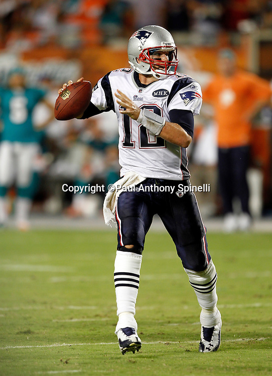 New England Patriots quarterback Tom Brady (12) scrambles as he throws a pass during the NFL week 1 football game against the Miami Dolphins on Monday, September 12, 2011 in Miami Gardens, Florida. The Patriots won the game 38-24. ©Paul Anthony Spinelli