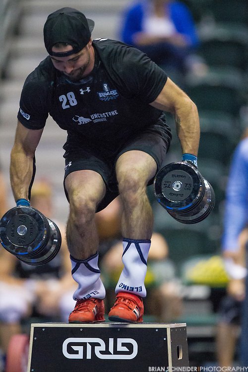 """Aug 26, 2014; Fairfax, VA, USA; The DC Brawlers Ken Battiston #28 performs DB Burpee-over-Box 2x75lb 24"""" against the Philadelphia Founders during a regular season National Pro Fitness League (NPGL) GRID match at the Patriot Center in Fairfax, VA. Athletes competed in the McKinley match format. Mandatory Credit: Brian Schneider-NPGL"""