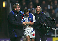 Photo: Andrew Unwin.<br />Newcastle United v Blackburn Rovers. The Barclays Premiership. 21/01/2006.<br />An injured Paul Dickov (C) of Blackburn is helped from the field.