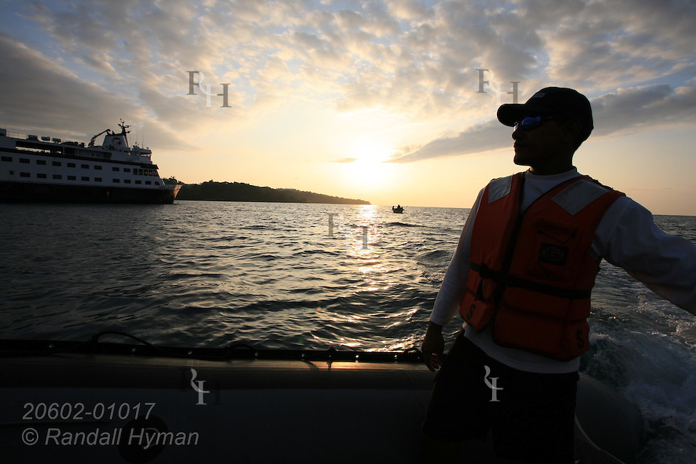 Crewman from Cruise West's ship, Pacific Explorer, pilots Zodiac in Drake Bay along Pacific Ocean's Osa Peninsula, Costa Rica.