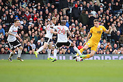 Fulham striker Sone Aluko (24) tackling Preston North End attacker Jordan Hugill (25) during the EFL Sky Bet Championship match between Fulham and Preston North End at Craven Cottage, London, England on 4 March 2017. Photo by Matthew Redman.