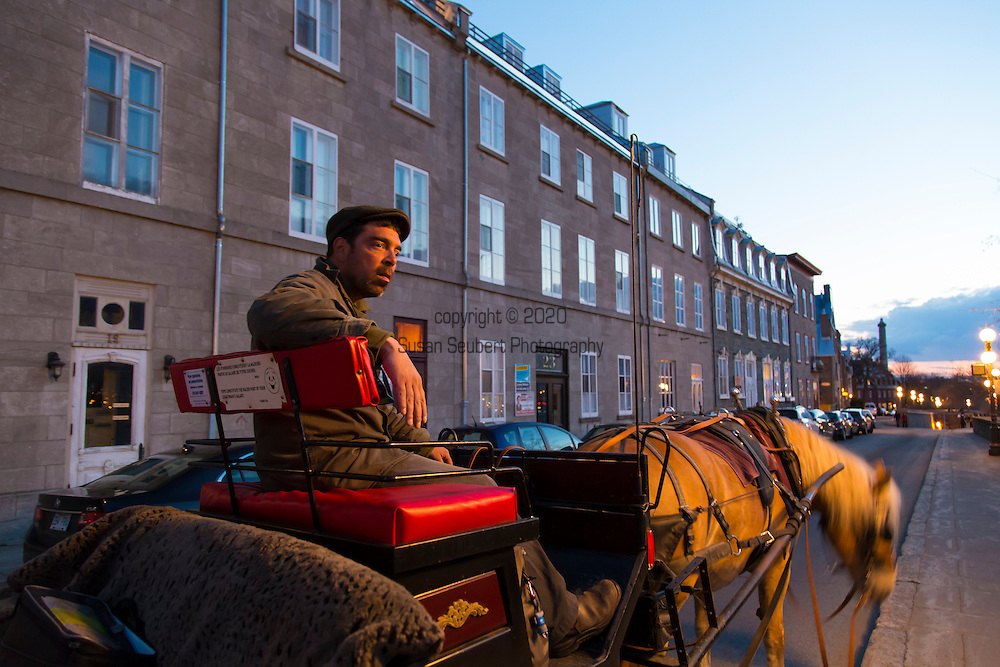 A guided horse-drawn carriage tour in Quebec City, Canada.