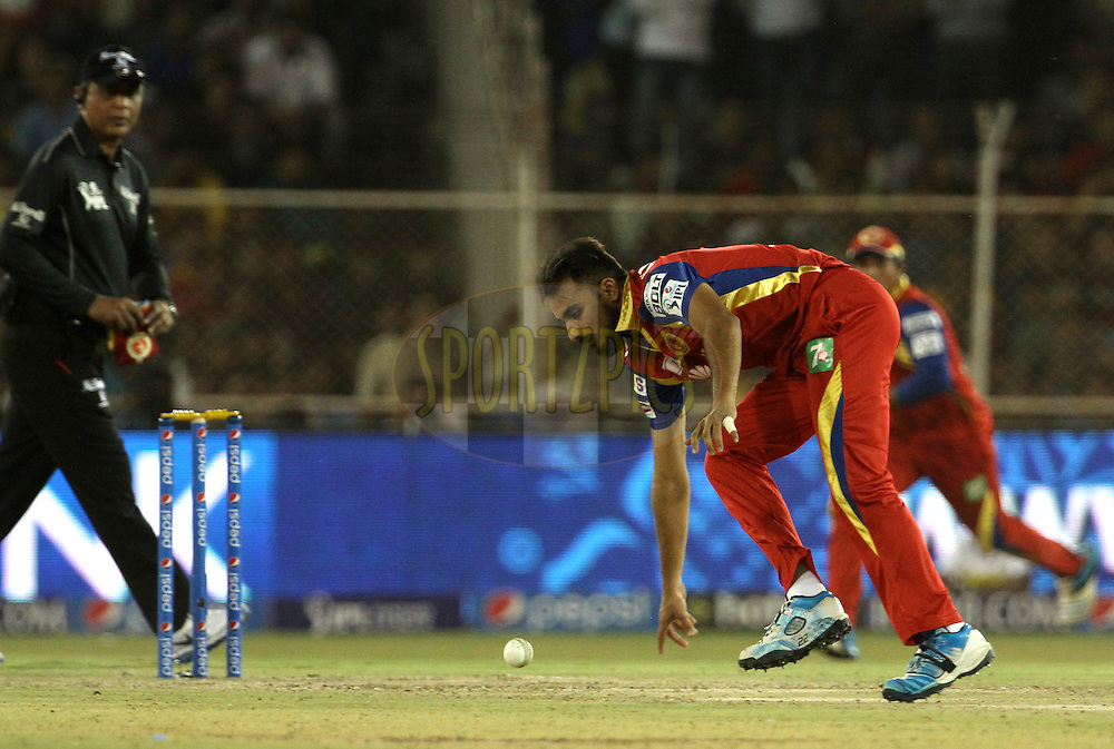 Royal Challengers Bangalore player Harshal Patel fields of his own bowling during match 22 of the Pepsi IPL 2015 (Indian Premier League) between The Rajasthan Royals and The Royal Challengers Bangalore held at the Sardar Patel Stadium in Ahmedabad , India on the 24th April 2015.<br /> <br /> Photo by:  Vipin Pawar / SPORTZPICS / IPL