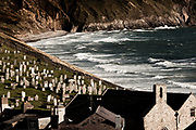 Life grows in the graveyard at Aberdaron. The graves all face out to the Irish Sea, the prevailing winds and the sunsets. If spirits really do exist, than I can think of no finer place to rest, a harbour where many pilgrims have rested on their way to the final destination, the small Celtic island of Ynys Enlli.