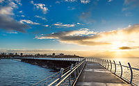 The breakwater off the southern shore of Victoria, BC is a popular spot to walk at sunrise.