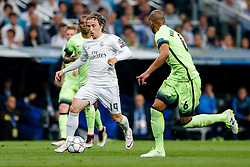 Luka Modric of Real Madrid is challenged by Fernando of Manchester City - Mandatory byline: Rogan Thomson/JMP - 04/05/2016 - FOOTBALL - Santiago Bernabeu Stadium - Madrid, Spain - Real Madrid v Manchester City - UEFA Champions League Semi Finals: Second Leg.