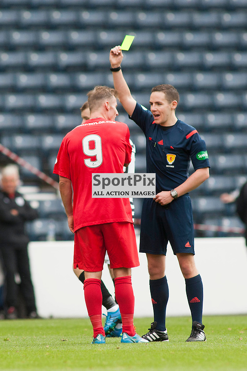 Gary Fraser (Montrose 9) shown the yellow card by referee David Munro in the Queen's Park v Montrose SPFL2 at Hampden Park on 03 October 2015<br />
