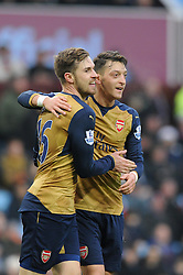 Aaron Ramsey of Arsenal celebrates with Mesut Ozil of Arsenal who set up the goal - Mandatory byline: Dougie Allward/JMP - 13/12/2015 - Football - Villa Park - Birmingham, England - Aston Villa v Arsenal - Barclays Premier League