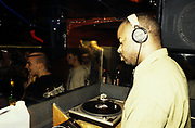 Techno DJ, Juan Atkins, DJing in a club, UK 1990's