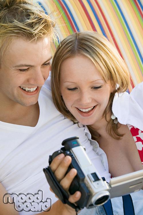 Couple Watching Video Camera