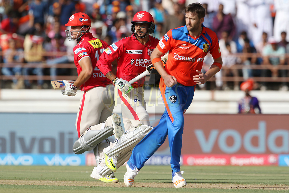 Akshar Patel of Kings XI Punjab and Marcus Stoinis of Kings XI Punjab takes a run during match 26 of the Vivo 2017 Indian Premier League between the Gujarat Lions and the Kings XI Punjab held at the Saurashtra Cricket Association Stadium in Rajkot, India on the 23rd April 2017<br /> <br /> Photo by Vipin Pawar - Sportzpics - IPL