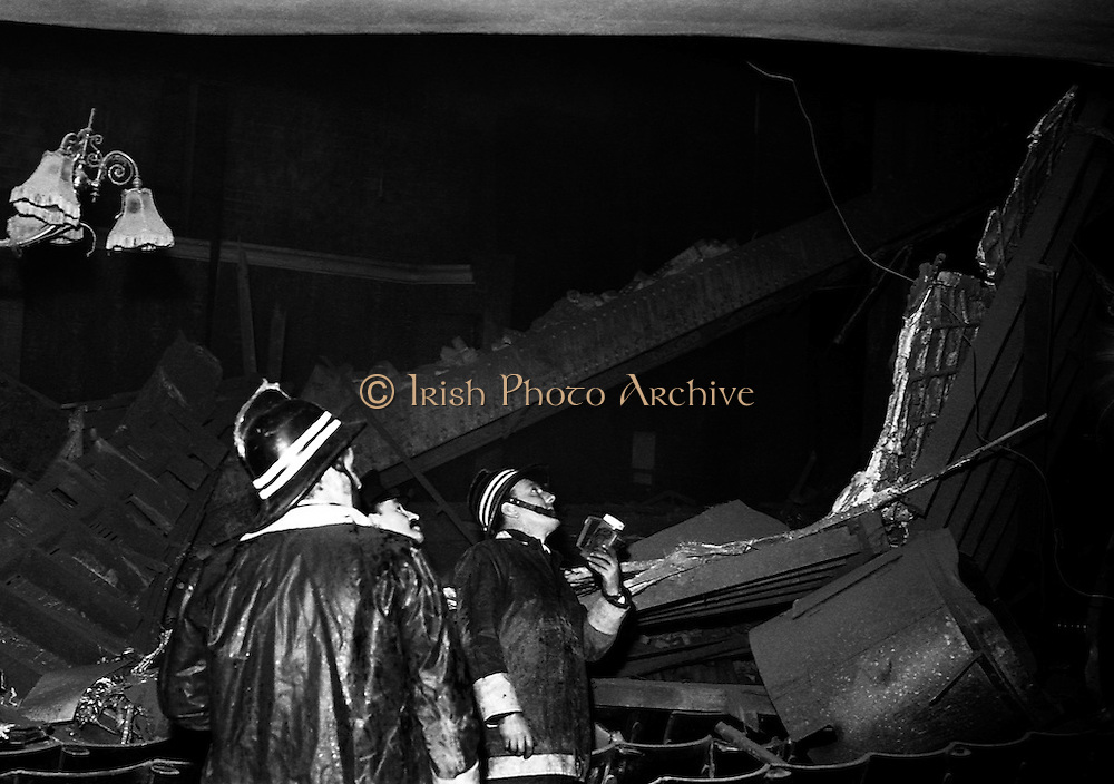 Firemen search the wreckage after the collapse of the front of stage of the Olympia Theatre. The collapse happened during the lunch break of the rehearsal of 'West Side Story', due to open that night.<br /> <br /> 05/11/1974