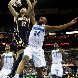 April 3, 2011; New Orleans, LA, USA; Indiana Pacers power forward Josh McRoberts (32) is fouled by New Orleans Hornets power forward Carl Landry (24) on a dunk during the fourth quarter at the New Orleans Arena. The Hornets defeated the Pacers 108-96.  Mandatory Credit: Derick E. Hingle