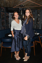 Left to right, LAVINIA BRENNAN and LADY NATASHA RUFUS-ISAACS at a dinner to celebrate London Fashion Week SS 2015 and the opening of Ramusake at 92 Old Brompton Road, London on 15th September 2014.