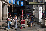 With a further 89 UK covid victims in the last 24hrs, bringing the total victims to 43,995 during the Coronavirus pandemic, shops continue opening along London's Oxford Street where social distance and hygiene advice towers are located for shoppers to observe restriction rules, on 2nd July 2020, in London, England.