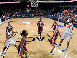 Virginia's Monica Wright shoots over VT's Laura Haskins. The Virginia Tech Hokies overcame a 14 point Virginia lead to beat the Cavaliers 60-58 on their home court at the John Paul Jones Arena in Charlottesville, VA.