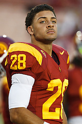 September 11, 2010; Los Angeles, CA, USA;  Southern California Trojans running back Dillon Baxter (28) warms up before the game against the Virginia Cavaliers at the Los Angeles Memorial Coliseum. USC defeated Virginia 17-14.