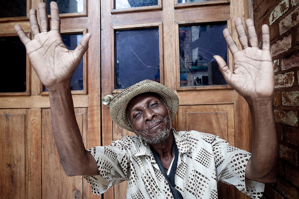 A man raises his hands in Les Cayes on the Tiburon Peninsula, Haiti