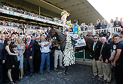 Victor Espinoza on American Pharaoh celebrates a historic victory at the 147th Belmont Stakes at Belmont Park Race Track, securing the first Triple Crown win in 37 years with a time of 2:26.65, as timed by Longines, the official timekeeper of the Triple Crown, Saturday, June 6, 2015 in Elmont, N.Y. (Photo by Stuart Ramson/Invision for Longines/AP Images)
